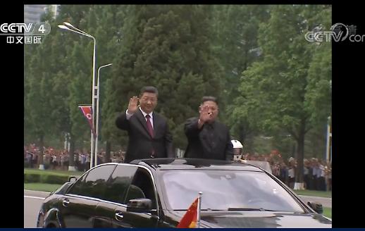 [중국포토] CCTV가 보도한 시진핑·김정은 만남