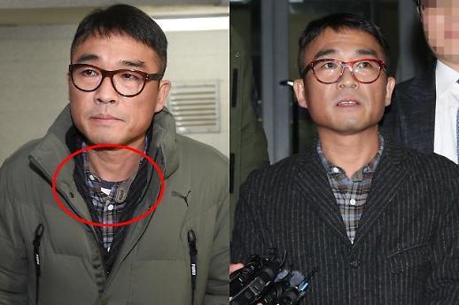 [슬라이드 화보] 배트맨티 논란 여파? 옷 가리고 경찰서 나온 김건모