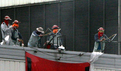 .Fired Ssangyong Workers Use Slingshots Amid Standoff .
