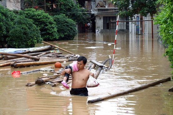 .1.3 Million Flee as China Flooding Kills 155.
