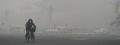 .Beijing to toughen anti-air pollution measures.