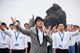.K-pop legend Lee Seung-chul makes unification song debut with North Korean defectors at Dokdo.