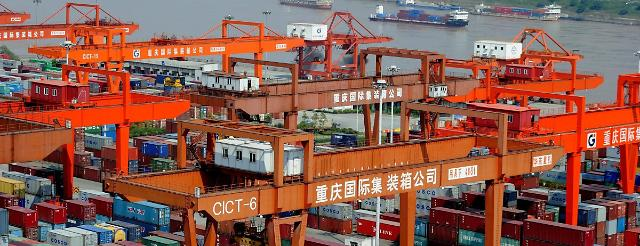 Chinas GDP growth slows to 7.4% in 2014