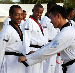 .18 foreign soldiers on UN peace-keeping mission in South Sudan earn black belts in taekwondo .