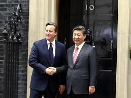 .习近平同英国首相卡梅伦举行会谈.