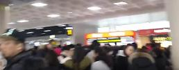 .Chinese tourists protest over flight delays caused by snowstorm.