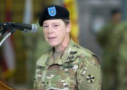 US female brigadier general on duty as deputy commander