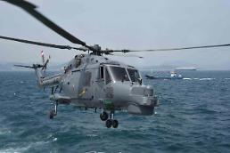 .South Korean navy rescuers retrieve bodies of helicopter crew .