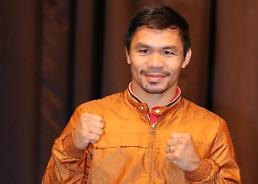 .Filipino boxing hero Pacquiao to test punch force in S. Korea.