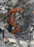 Two demolition workers trapped under rubble