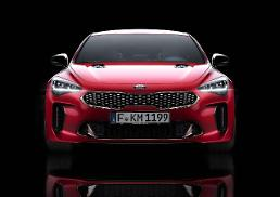 .Kia unveils premium performance sedan Stinger at Detroit Auto Show.