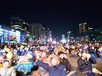 12차 촛불집회...10만 한파속에 집결