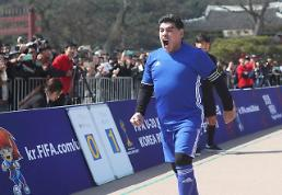 Argentine football legend Maradona shows off skills before fans