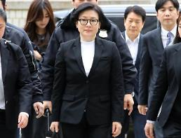 Lotte Group founder, two sons and wife appear in court for trial