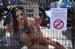 .[Global Pix] An activist stages a protest in a cage against animal testing.