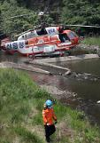 One dies in emergency landing by fire-fighting helicopter