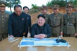 .N. Korea leader hails test of new missile capable of carrying nuclear warhead  .