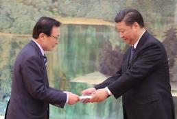 .Moon faces tough diplomacy despite signs of thaw in frozen ties with China .