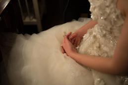 .韩年轻人大呼结不起婚 人均花销2.6亿韩元.