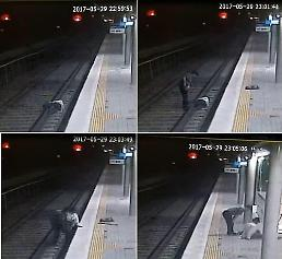 .Railway staff saves suicidal 86-year-old just before train arrives.