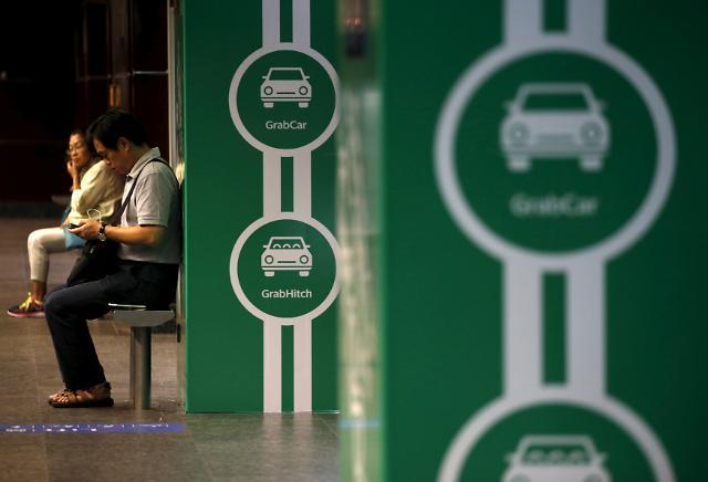 우버·그랩 때문에 베트남 택시기사 8000명 짐쌌다