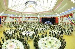 .N. Korea leader scoffs at international criticism to host banquet for ICBM developers.