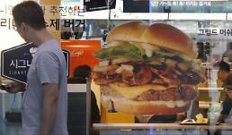 .McDonalds head in S. Korea apologizes over hamburger disease cases.
