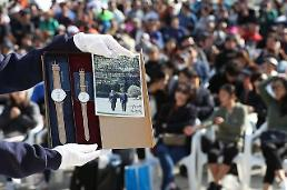 .President Moon related items receive love calls at charity auction.