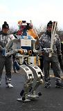.Humanoid robot bears Pyeongchang Olympic Torch for first time.