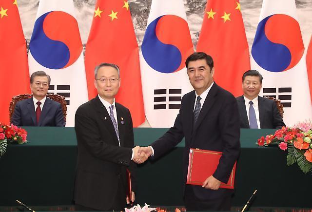 韩中签署FTA后续协商等多项谅解备忘录