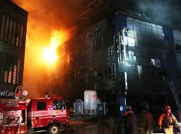 .Fire kills 29 people at building for public sauna and fitness center.