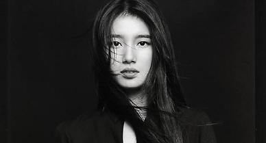 .Suzy unveils teaser images for upcoming pre-release song.