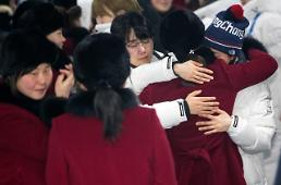.N. Korean ice hockey players head home in tearful farewell.