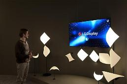 .LG Display showcases sound-generating OLED lamp at trade show.