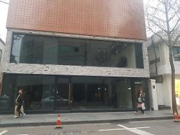 .房费疯涨游客不在 昔日首尔名品街如今尽显荒凉.