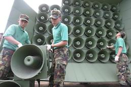 .S. Korea turns off loudspeakers for cross-border propaganda broadcasting .