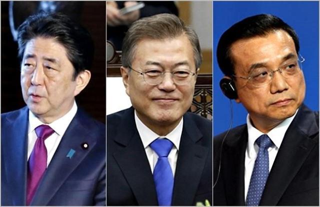 文在寅明日出席韩日中首脑会议 韩日穿梭外交走上正轨