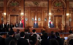 .Leaders of S. Korea, Japan and China vow to push for denuclearization.