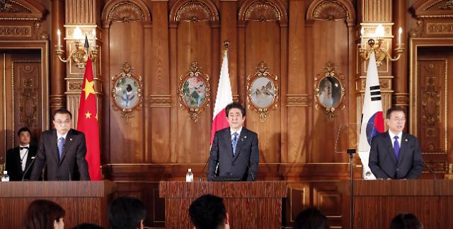 韩中日领导人就共促半岛无核化达成共识