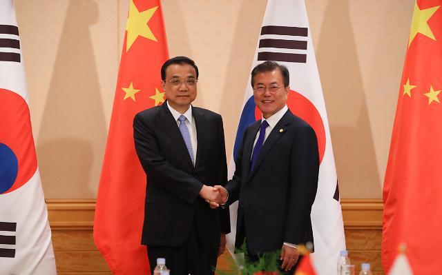 韩中领导人就半岛局势共同治霾交换意见