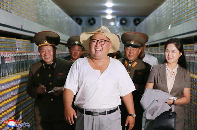 金正恩视察虾酱加工工厂