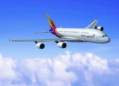 .Asiana reduces international flights to put troubled system back in shape.