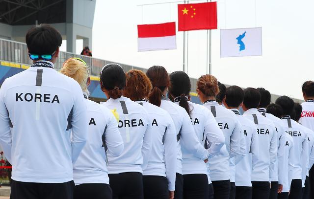 韩朝联队龙舟比赛获铜牌 半岛旗冉冉升起