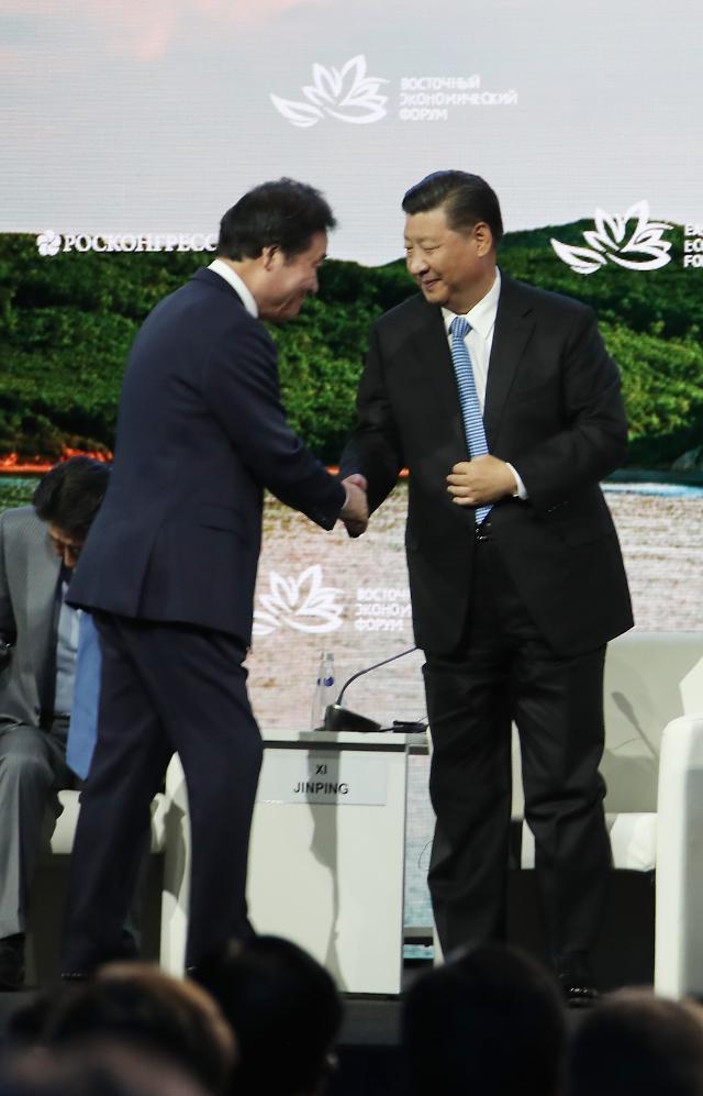 习近平会见韩国总理李洛渊
