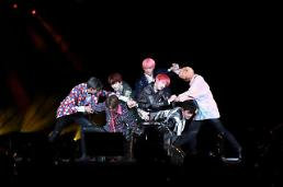 .K-pop band BTS cancels collaboration with controversial Japanese producer.