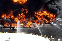 .Firefighters put down fire at oil storage place in 17-hour operation  .