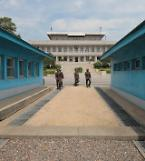 .UNC team attends inter-Korean meeting to disarm truce villlage.