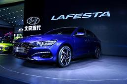 .Hyundai showcases sporty fastback sedan targeting young Chinese.