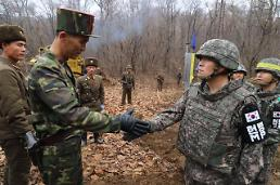 .Koreas connect cross-border road for excavation of war remains.