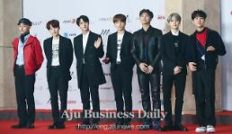 .K-pop band BTS grabs Album of the Year prize at home.